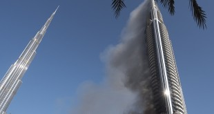 Fea0067274        picture by Geoff Pugh The Address Downtown Hotel, Dubai, still smouldering this morning.